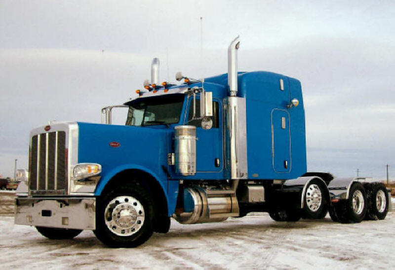 Peterbilt model 389 truck tractor picture Blue highway unit with sleeper bunk and drop down tri-axle to carry a little extra weight